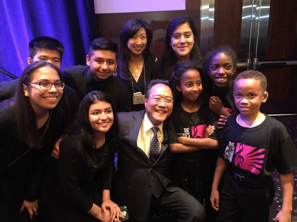 Yo-Yo Ma with students from The People's Music School, with whom he performed at Forefront and TPMS Exec Director Jennifer Matsuzawa.